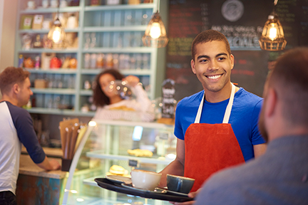 Young man working at coffee shop