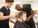 student giving haircut