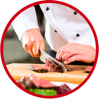 Image of a chef slicing a piece of cooked prime rib.