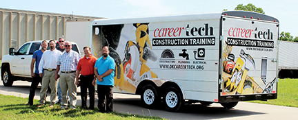 Pictured with the trailer are, from left, ODCTE employees Chris Benson, Jeremie Moore, Kyle Johnson, Greg Dewald, Tim Hodges and Corey Haynes.