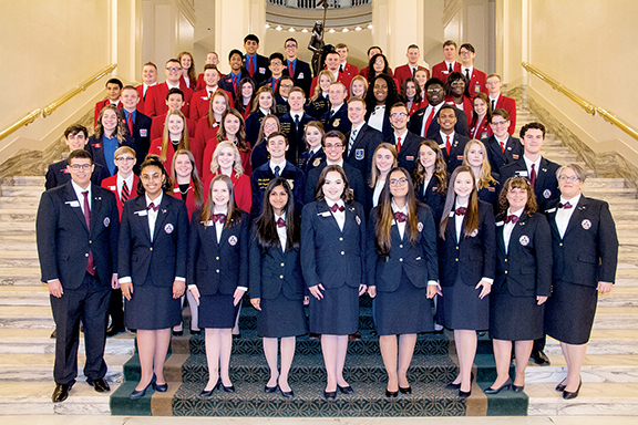 Oklahoma CareerTech student organization officers stand on steps outside the state Capitol rotunda.