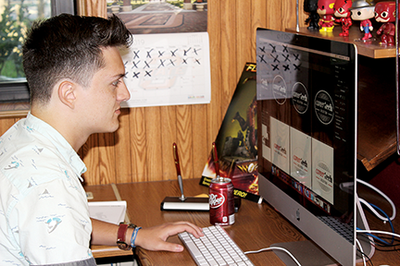 Gunner Fullbright works on a design on his computer.