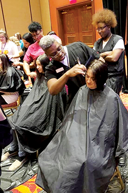 Oklahoma HOSA members organized a hair donation event at the HOSA State Leadership Conference. Here, cosmetology students cut hair to donate to Children With Hair Loss.