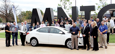 Representatives of Gulf States Toyota, Oklahoma CareerTech, Fowler Toyota and Moore Norman Tech gather for the donation of a Toyota Corolla.
